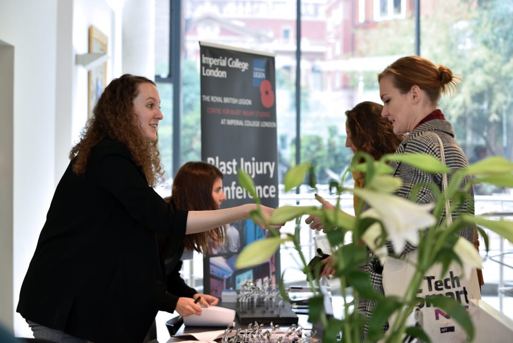 Dr Lucy Foss and Lt Emily Ashworth checking in delegates at the registration desk at the Blast Injury Conference 2018.